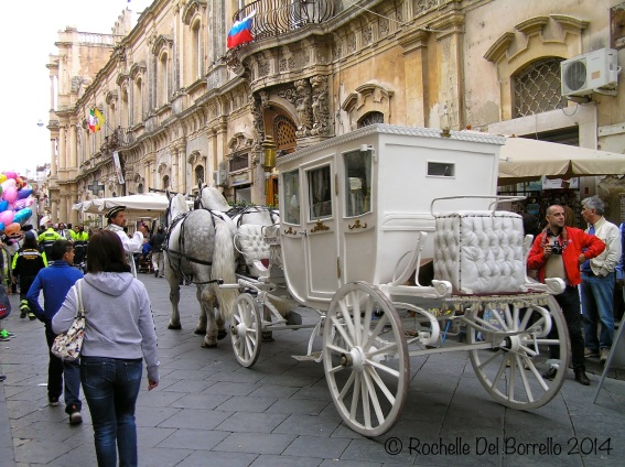 Elaborate carriage preparing for the medieval procession at Noto.