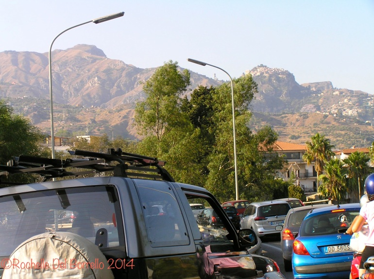 Ferragosto Traffic, with a view of Castel Mola and Taormina on the way to Giardini Naxos, Messina.