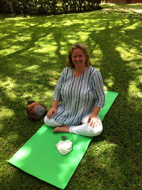 Karolyn on yoga mat in India